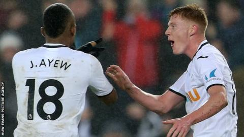 Swansea goal-scorers Jordan Ayew and Sam Clucas celebrate against Arsenal