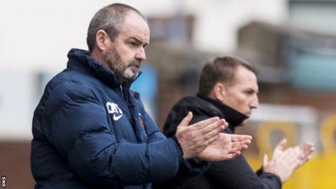 Steve Clarke applauds his Kilmarnock side as Celtic boss Brendan Rodgers looks on