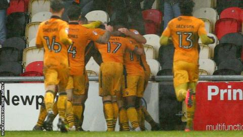 Players celebrate Tom Owen-Evans' goal