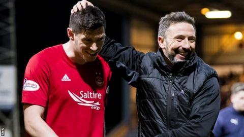 Aberdeen scorer Scott McKenna and manager Derek McInnes celebrate