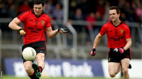 Marty Clarke and Mark Poland in action for the Mourne team in 2011