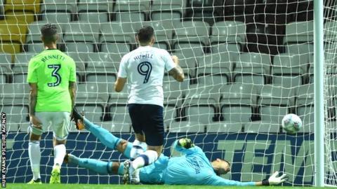 Cardiff goalkeeper Neil Etheridge is beaten by Josh Harrop's free-kick for Preston North End