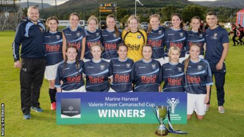 Badenoch and Strathspey celebrate with the Valerie Fraser Camanachd Cup
