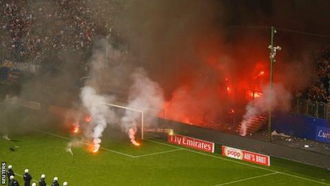 Hamburg fan protest: Chaotic scenes as flares stop game, massive police response