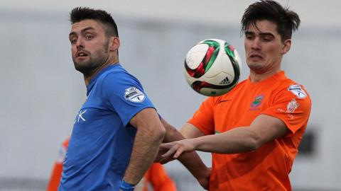 Glenavon's Eoin Bradley and Jimmy Callacher of Linfield in aerial action during the entertaining league game at Mourneview Park