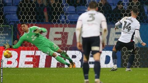 Gary Madine fires the ball past Cardiff goalkeeper Neil Etheridge - diving to his right - from the penalty spot