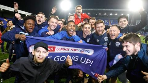 Bury players and fans celebrate promotion from League Two