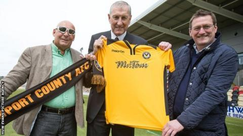 Les Scadding, Terry Butcher and Howard Greenhaf with a Newport County shirt on the Rodney Parade pitch