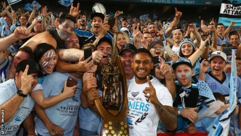 Ben Barba celebrates winning the 2016 NRL Grand Final with Sharks fans