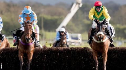 Un De Sceaux loses ground on Fox Norton (right) as they jump the final fence