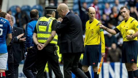 Peter Houston heads up the tunnel at Ibrox after the 3-1 defeat