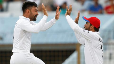 Afghanistan's Rashid Khan celebrates with his teammates