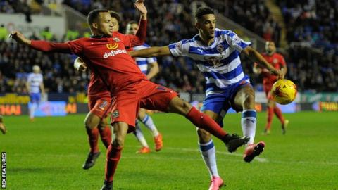 Blackburn's Marcus Olsson (left) challenges Reading's Nick Blackman
