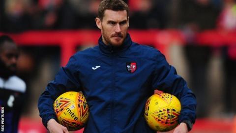 Exeter coach Matt Taylor oversees a warm-up