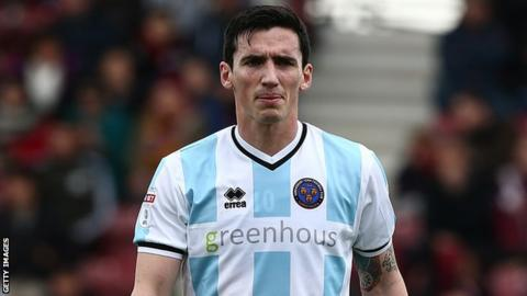 Louis Dodds looks on during Shrewsbury's game at Northampton in April 2017