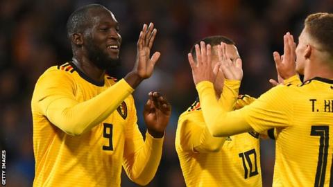 Romelu Lukaku (left) celebrates scoring for Belgium