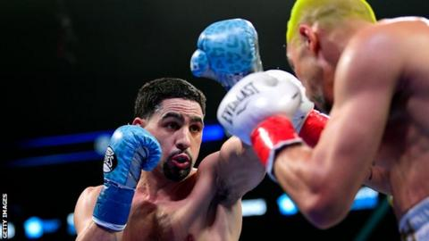 Danny Garcia and Ivan Redkach in the ring