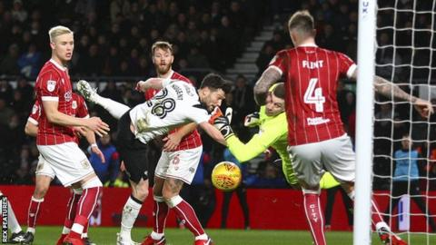 Aden Flint clears off the line for Bristol City