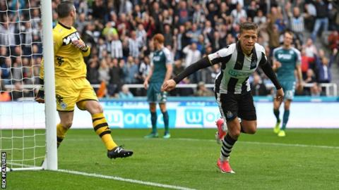 Dwight Gayle opens the scoring for Newcastle against Wigan