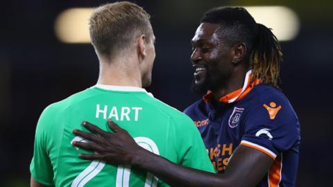 Joe Hart embraces Emmanuel Adebayor