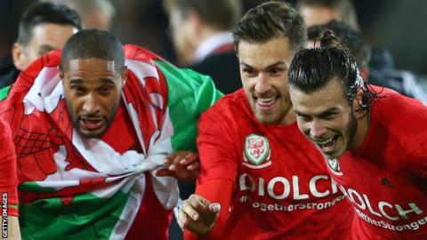 Ashley Williams, Aaron Ramsey and Gareth Bale celebrate Wales' Euro 2016 qualification