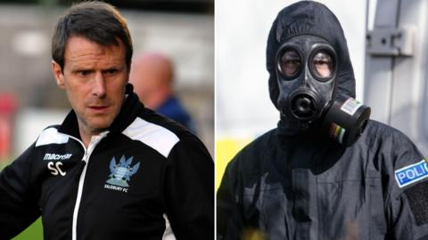 Salisbury FC boss Steve Claridge and a police officer in a protective suit and mask in Salisbury