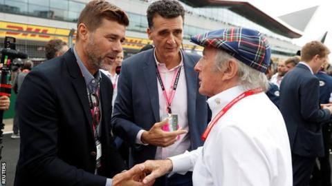 Mauricio Pochettino shakes hands with Sir Jackie Stewart