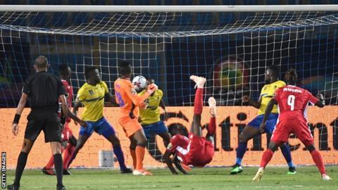 Michael Olunga celebrates