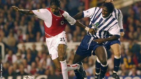 Darren Moore (right) tussles with Arsenal striker Kanu