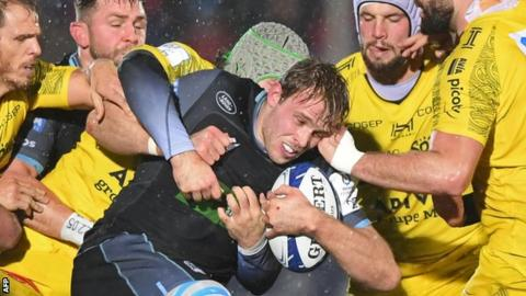 Finn Russell Jonny Gray in action for Glasgow