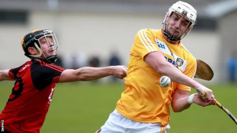Down's Scott Nicholson challenges Conor McKinley in the Ulster derby encounter at Cushendall