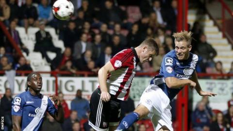 Michael Morrison heads Birmingham's opening goal at Brentford