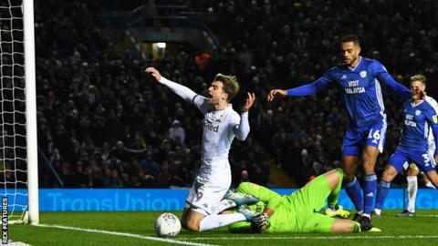 Patrick Bamford scored from the spot for Leeds after being brought down by Cardiff keeper Neil Etheridge