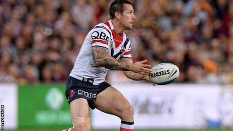 Mitchell Pearce passes the ball