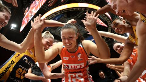 SYDNEY, AUSTRALIA - AUGUST 19: Susan Pettitt of the Giants runs through a guard of honour after announcing her retirement during the Super Netball Preliminary Final match between the Giants and the Lightning at Qudos Bank Arena on August 19, 2018 in Sydney, Australia. (Photo by Ryan Pierse/Getty Images)