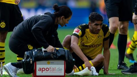 Morocco's Achraf Hakimi being attended to by Dortmund medical staff