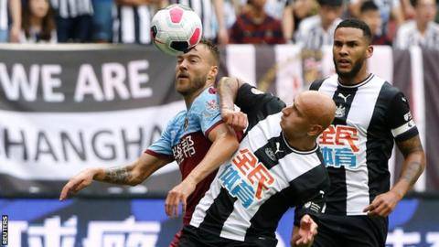 Newcastle midfielder Jonjo Shelvey battles for possession against West Ham in Shanghai