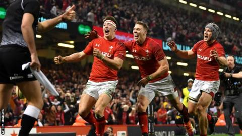 Josh Adams, Liam Williams and Jonathan Davies celebrate