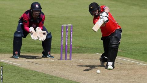 Paul Horton drives the ball towards mid-off for four runs for Leicestershire against Northamptonshire