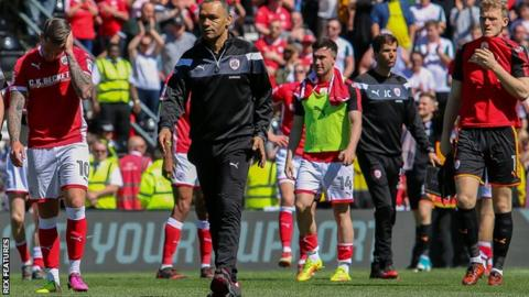 Barnsley's players and staff trudge off the Pride Park pitch after their relegation is confirmed