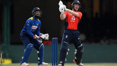 England captain Eoin Morgan hits a six against a Sri Lanka Cricket XI in Colombo