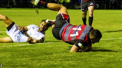 Edinburgh's Damien Hoyland touches the ball down to score his side's second try of the game