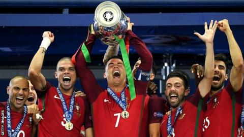 bf8cb98fc83 Portugal captain Cristiano Ronaldo raises the Euro 2016 trophy surrounded  by team-mates. Portugal beat France in the final ...