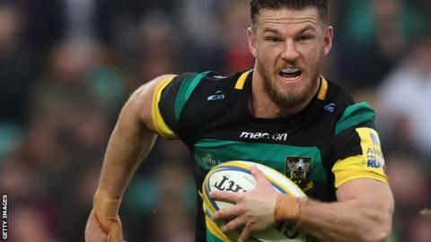 Rob Horne makes a break for Northampton