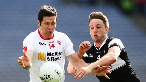 Tyrone's Sean Cavanagh and Sligo's Daniel Maye keep their eyes on the ball during Saturday's Croke Park curtain-raiser