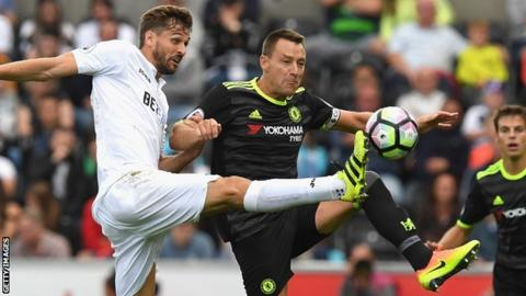 John Terry (right) in action against Swansea