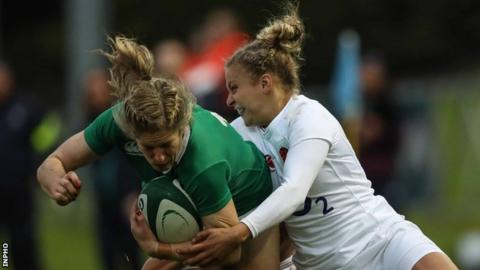 Ireland's Alison Miller is tackled by England's Kay Wilson in Sunday's game at the UCD Bowl