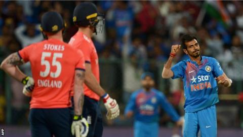 Ben Stokes and Liam Plunkett look on as Yuzvendra Chahal celebrates a wicket