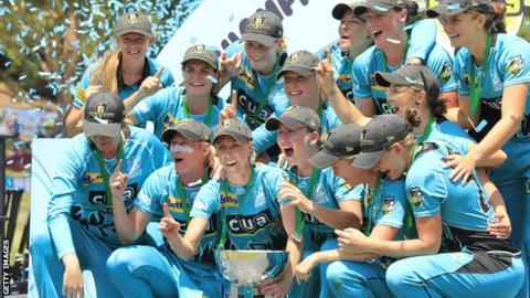 Brisbane Heat celebrate with the WBBL trophy