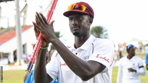 Jason Holder celebrates West Indies' series win in Antigua